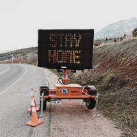Image of Stay Home road sign